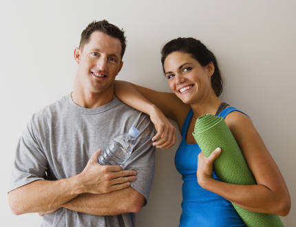 Group of smiling people in fitness clothes